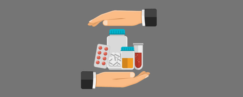Two hands holding complementary and alternative medicines